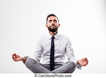 relaxed business man in meditation pose
