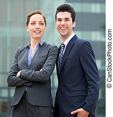 Relaxed businessman and business woman smiling