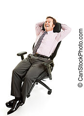 Relaxed Businessman Ergonomics - Businessman leans back and...