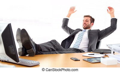 Relaxed businessman putting his feet up in the office