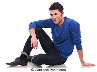 relaxed casual man sitting on white background