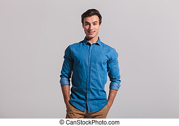 relaxed casual man standing with hands in pockets