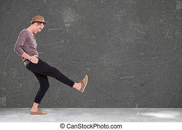 young man kicking and smiling