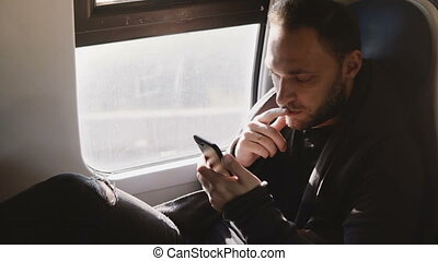 Relaxed comfortable Caucasian freelance worker texting on...