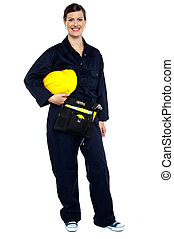 Relaxed construction worker with yellow helmet