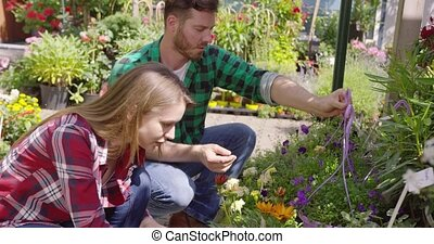 Relaxed couple spending time in gardening