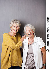 Relaxed elderly ladies enjoying a laugh