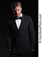 relaxed elegant young fashion man in suit