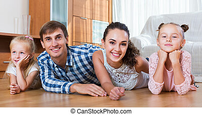 Relaxed family in domestic interior