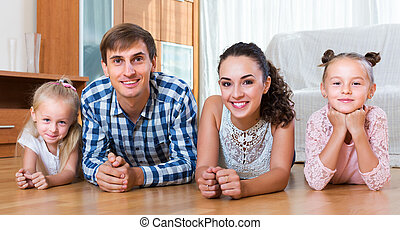 Relaxed family of four posing