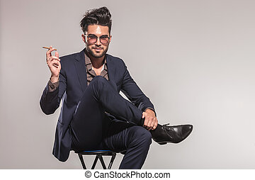 relaxed fashion business man smoking