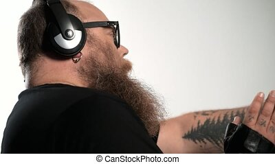 Relaxed fat man undergoing movement during his favorite song