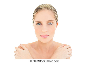 Relaxed fresh blonde woman looking at camera