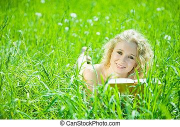 Relaxed girl enjoying reading book