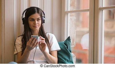 Relaxed Girl Listens to Music on Phone