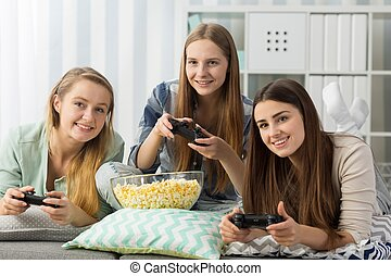 Relaxed girlfriends playing a video game