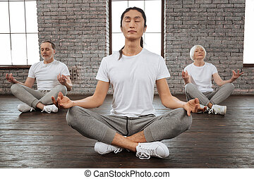 Relaxed group of healthy people while meditating