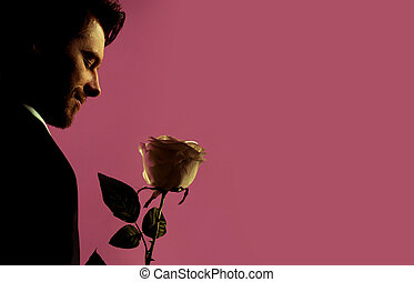 Relaxed handsome manager holding the rose