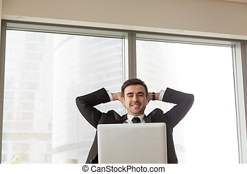 Relaxed happy businessman sitting hands behind head looking...