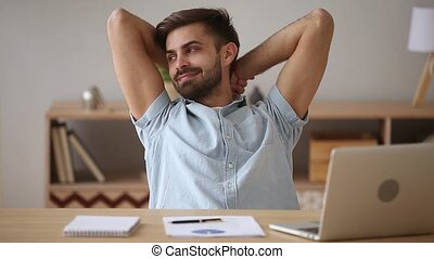 Relaxed happy man taking break chilling satisfied with...