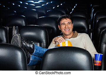 Relaxed Happy Man Watching Movie
