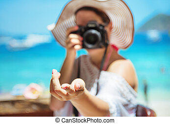 Relaxed woman taking a photo - tropical area