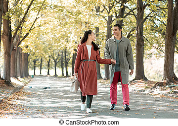 Relaxed loving couple walking after dinner in cafe