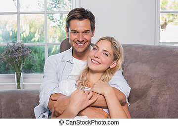 Relaxed loving man embracing woman