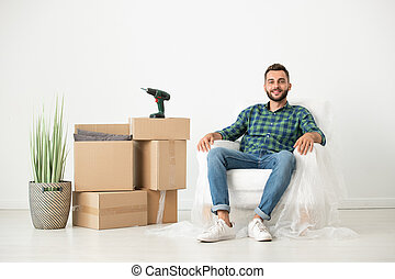 Relaxed man in new house