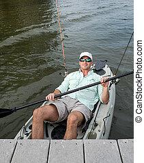 Relaxed Man Kicks Back in Fishing Kayak