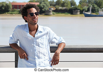 Relaxed man standing on a pontoon