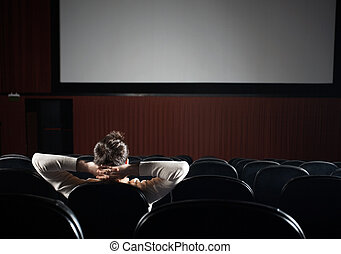 Relaxed Man Watching Film In Theater