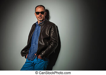 relaxed senior casual man standing with hands in pockets