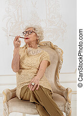 Relaxed senior lady is heavy smoker