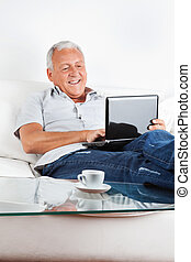 Relaxed Senior Man Working on Laptop