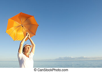 Relaxed Senior woman at ocean background