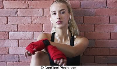 Relaxed sportswoman listening to music - Pretty young female...