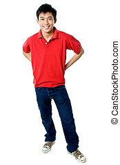 Relaxed teenager - Young teenage guy wearing red shirt and...