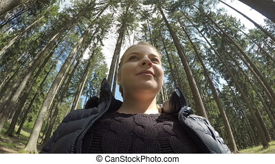 Relaxed trekker woman taking deep breath of fresh air in a mountain forest on vacation healthy life and recreational activity concept
