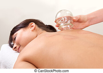 Relaxed Woman after Fire Cupping - Relaxed female with back...