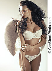 Relaxed woman angel with perfect tawny complexion - Relaxed...