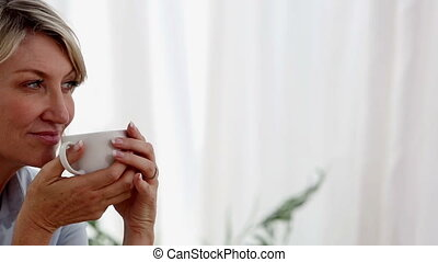 Relaxed woman drinking a cup of tea