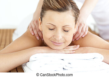 Relaxed woman enjoying a back massage