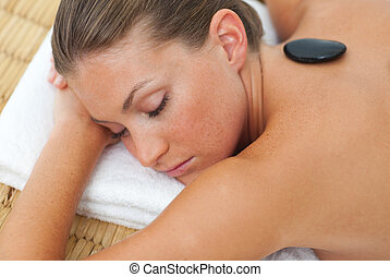 Relaxed woman getting spa treatment