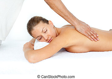 Relaxed woman having a back massage
