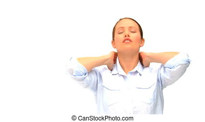 Relaxed woman having a neck pain against a white background