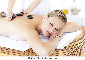 relaxed woman having stone massage