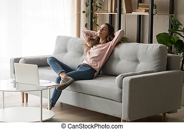 Relaxed woman leaned on couch closed eyes having day nap