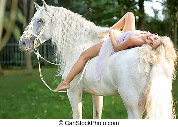 Relaxed woman lying on the horse