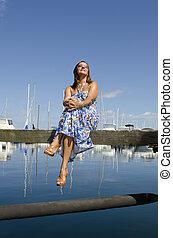 Relaxed Woman sitting at Marina